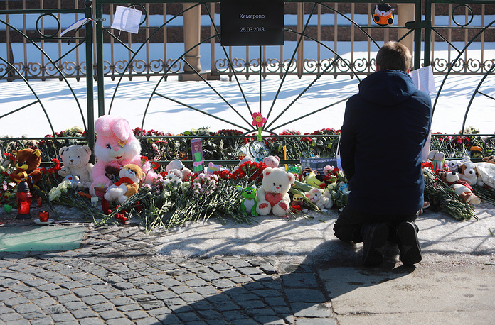 Toys and flowers brought to St Petersburg's Palace Square to mourn the victims of fire in Kemerovo