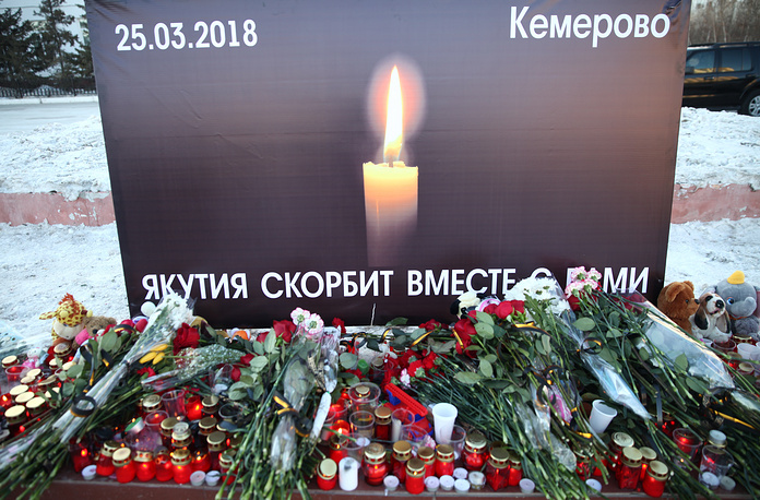 Flowers brought to Yakutsk's Lenin Square to mourn the victims of fire in Kemerovo