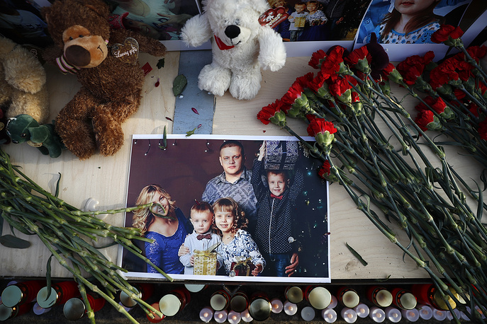 A photo showing a family of Igor Vostrikov, who lost his wife, three children and a sister in the fire in Kemerovo, seen during a ceremony commemorating the victims of a fire in Moscow