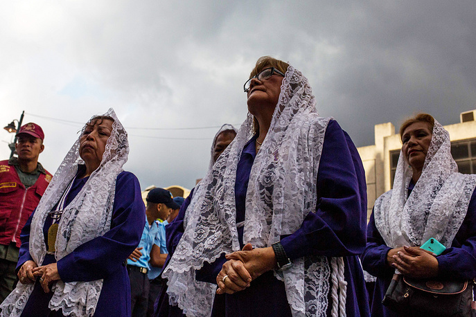 Parishioners participate in the annual Holy Wednesday procession, at the Basilica of Santa Teresa in Caracas, Venezuela