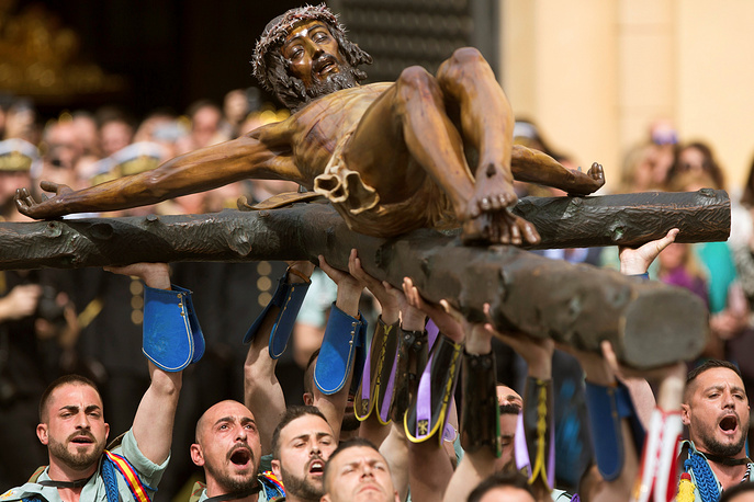 Soldiers of the Spanish Legion carry the figure of the Holy Christ of the Good Death from the St. Domingo Church to the Brotherhood House as they march through the streets of Malaga, Spain