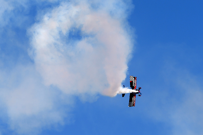 A Pitts Special S2 light aerobatic biplane performs a demonstration flight at the FIDAE 2018 aerospace exhibition held at Comodoro Arturo Merino Benitez International Airport, Chile