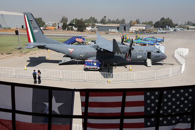 EADS CASA C-295 twin-turboprop tactical military transport aircraft and Embraer Super Tucano A-29A light attack aircraft