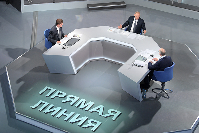 Channel One Deputy General Director and TV host Kirill Kleimenov, Russia's President Vladimir Putin, and VGTRK TV anchor Andrei Kondrashov