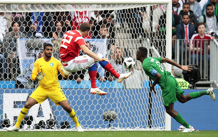 Russia's Artyom Dzyuba scores past Saudi Arabia's goalkeeper Abdullah Al-Mayouf in the 2018 FIFA World Cup opening match at Luzhniki Stadium, Moscow, June 13. Russia won the game 5:0