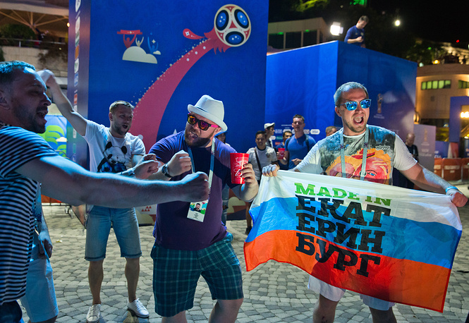 Russian football fans celebrate their team winning in Sochi