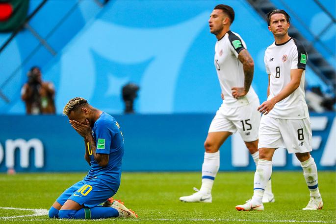 Brazil's Neymar, Costa Rica's Francisco Calvo and Bryan Oviedo seen after their group E football match at St Petersburg Stadium. Brazil won the game 2-0
