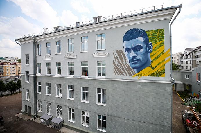 A wall mural with a likeness of Brazilian football player Neymar da Silva Santos Junior in central Kazan