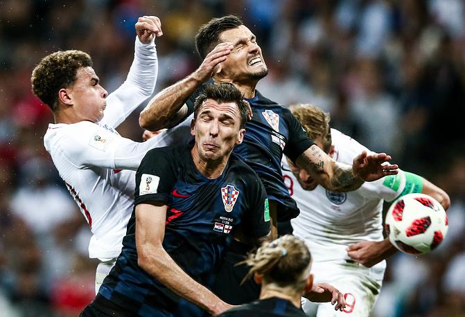 England's Delle Alli, Harry Kane, Croatia's Mario Mandzukic and Dejan Lovren in their 2018 FIFA World Cup semi-final match at Luzhniki Stadium, Moscow, July 11