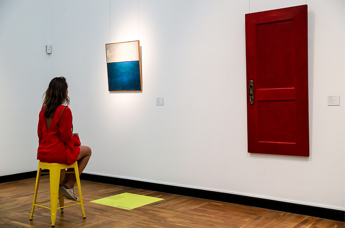 "A girl views Wall (1963) by Yevgeny Rukhin and Door (1965) by Mikhail Roginsky on display at the ""Tretyakov: Another Edition"" experimental exhibition opened at Moscow's State Tretyakov Gallery, Moscow, July 25"