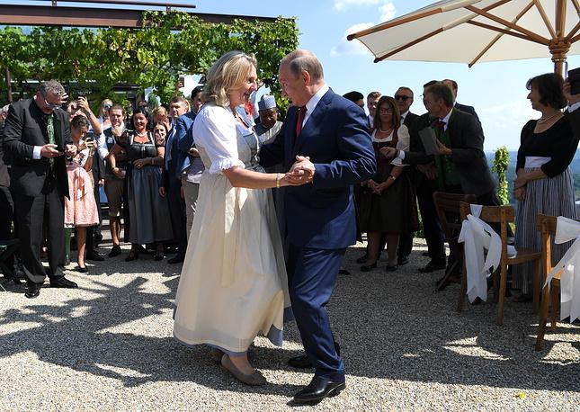 Russian President Vladimir Putin dances with Austrian Foreign Minister Karin Kneissl during her wedding to Austrian businessman Wolfgang Meilinger in Gamlitz, August 18