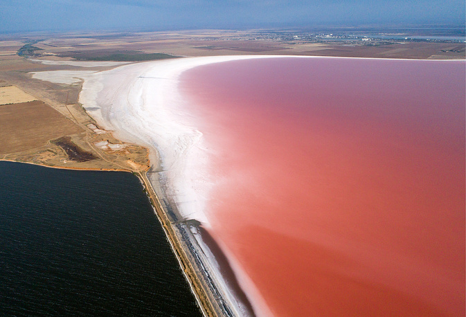 Pink waters of the Sasyk-Sivash salt lake, Crimea, August 29