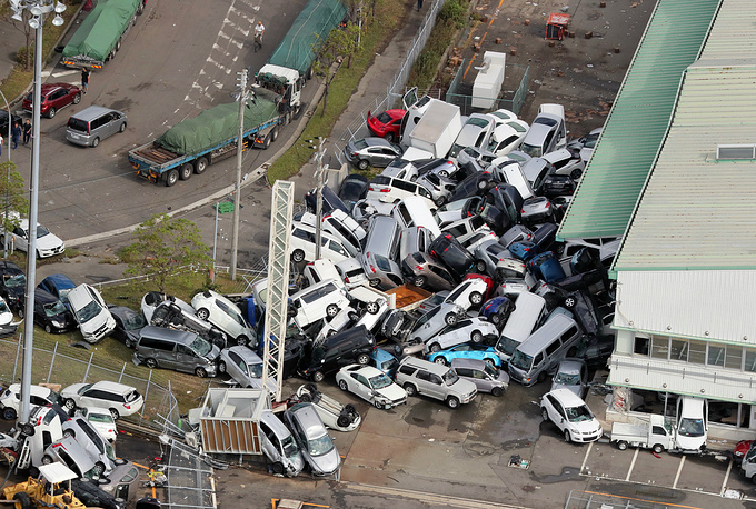 Cars pilled up a day after typhoon Jebi hit the area in Kobe, western Japan