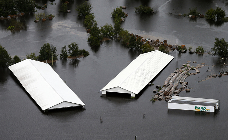Farm buildings are inundated with floodwater from Hurricane Florence