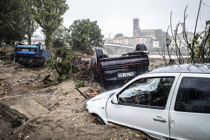 Damaged cars are pictured the day after floods hit the town of Trebes, southern France, October 16