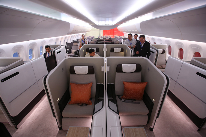 CR929 aircraft will be assembled in China and designed in Russia. The overall program budget is estimated at $13 bln. Photo: Visitors in the mock-up of the CRAIC CR929 airliner