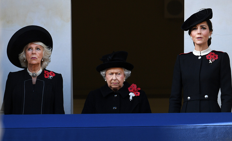 Britain's Queen Elizabeth II accompanied by Camilla, Duchess of Cornwall and Catherine, Duchess of Cambridge at the Cenotaph during Remembrance Sunday and the Centenary of the Armistice service on Whitehall in London, November 11
