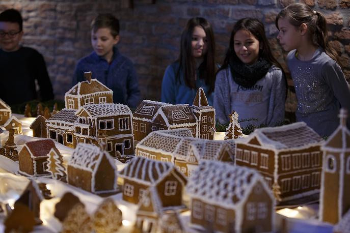 Visitors look at scale model of Szepetnek village made of gingerbread in Szepetnek, Hungary