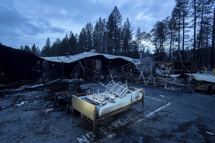 A bed rests outside Cypress Meadows Post-Acute, a nursing home leveled by the Camp Fire in Paradise, California, December 4