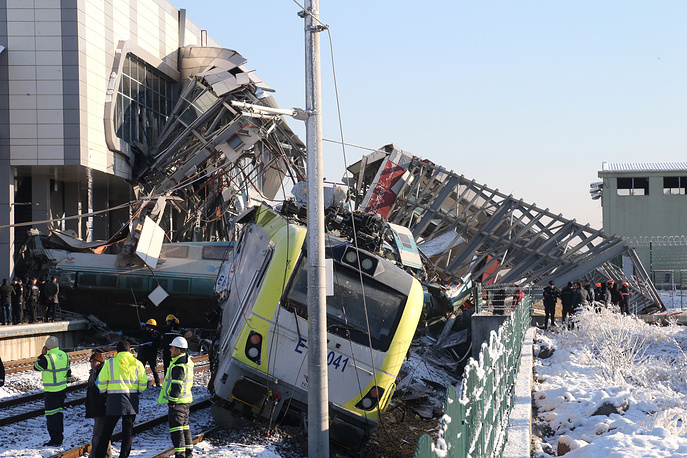 Firefighters and medics try to rescue victims after a high speed train accident in Ankara