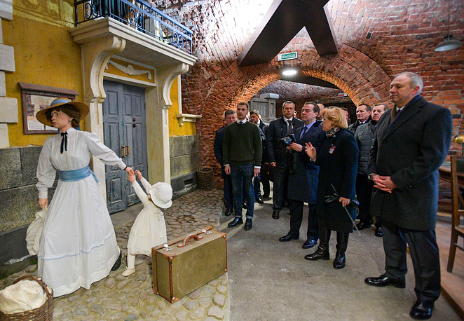 Russia's Prime Minister Dmitry Medvedev and Belarus' Prime Minister Sergei Rumas visit the War Museum at the Brest Hero-Fortress Memorial Complex, December 13