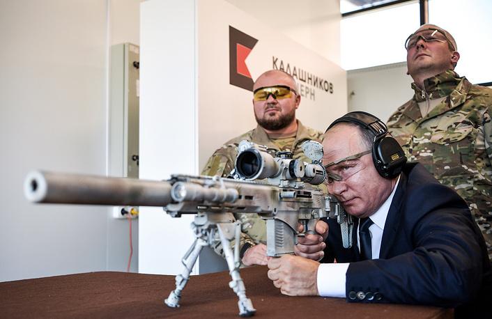 Russia's President Vladimir Putin aims a rifle at the Kalashnikov shooting centre at Patriot military park