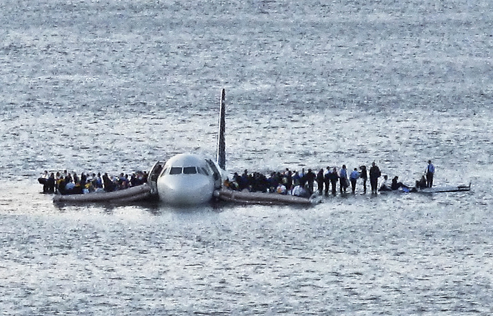 Passengers wait to be rescued on the wings of a US Airways Airbus 320 jetliner in the frigid waters of the Hudson River in New York, January 15, 2009