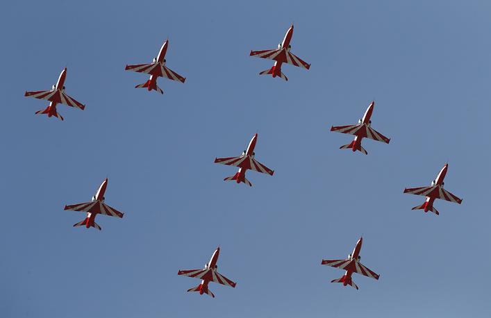 Indian Air Force Suryakiran aerobatic team performs aerobatic maneuvers at Yelahanka air base in Bangalore