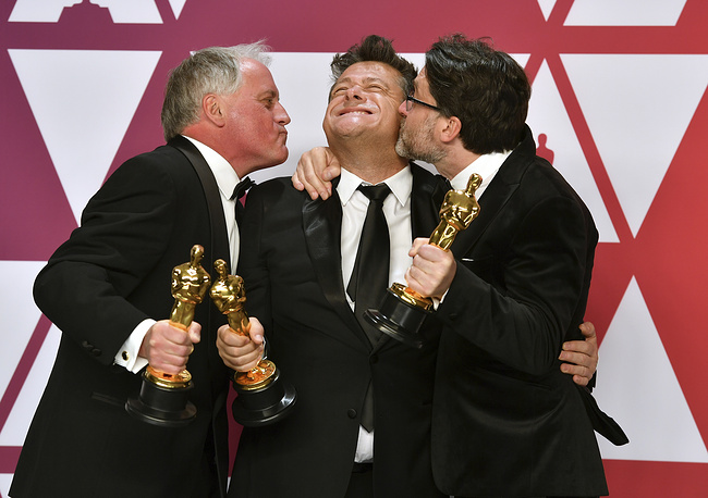 """Paul Massey, Tim Cavagin and John Casali pose with the award for best sound mixing for """"Bohemian Rhapsody"""""""