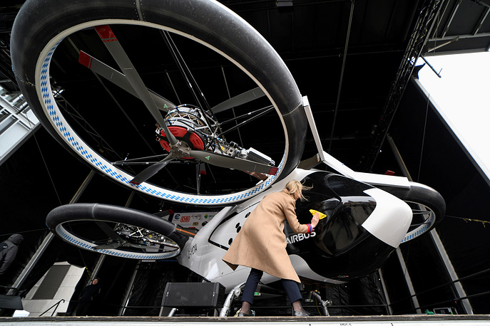 """A woman cleans a prototype of the electric air-taxi """"CityAirbus"""" set up on stage prior to its presentation in Ingolstadt, March 11"""