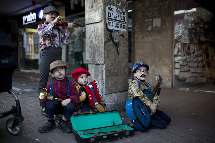 Costumed Jewish Ultra-Orthodox children taking part in the Jewish festival of Purim, in Bnei Brak, Israel, March 21. The Jewish holiday of Purim commemorates the Jews' salvation from genocide in ancient Persia, as recounted in the Book of Esther