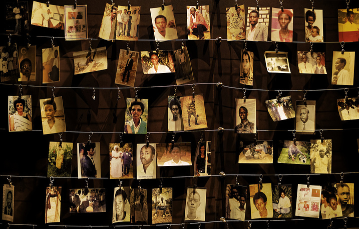Family photographs of some of those who died hanging on display in an exhibition at the Kigali Genocide Memorial centre in the capital Kigali, Rwanda