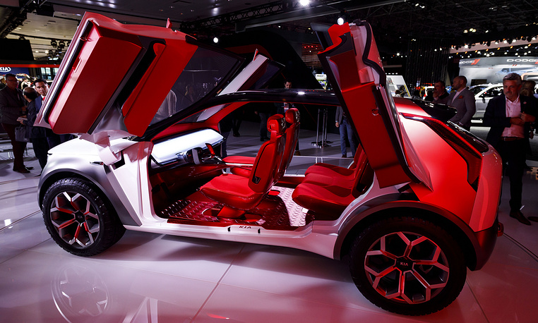 People looking over the Kia Habaniro, a concept car, during the 2019 New York International Auto Show