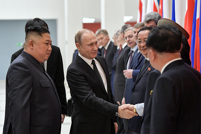 North Korean Leader Kim Jong Un and Russia's President Vladimir Putin are seen during a welcome ceremony at the Far Eastern Federal University on Russky Island