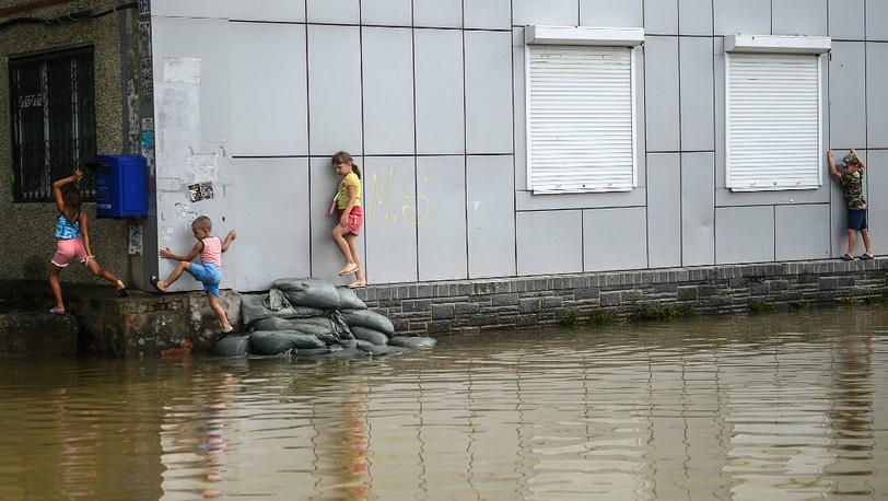 August 25. Children on a flooded street in Khabarovsk. Photo ITAR-TASS/ Olga Egoraeva
