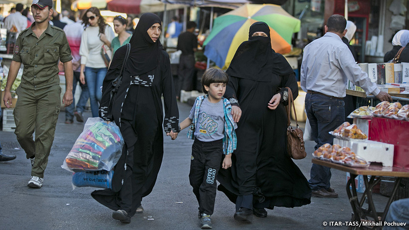 September 19.Two women and a child going about their business.