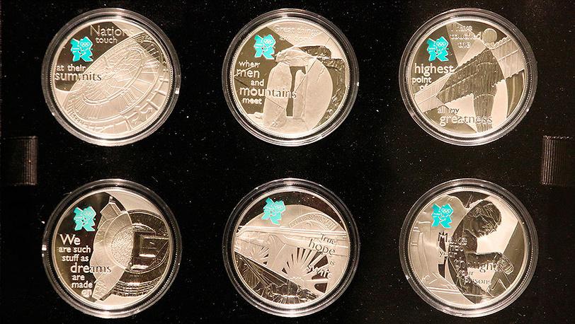 Презентация памятных монет Королевского монетного двора Великобритании, посвященная летним Олимпийским играм 2012 в Лондоне. Фото EPA/PAWEL SUPERNAK