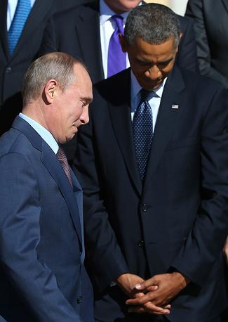 Президент РФ Владимир Путин и президент США Барак Обама на церемонии совместного фотографирования с делегатами-участниками саммита G20. 6 сентября 2013 года