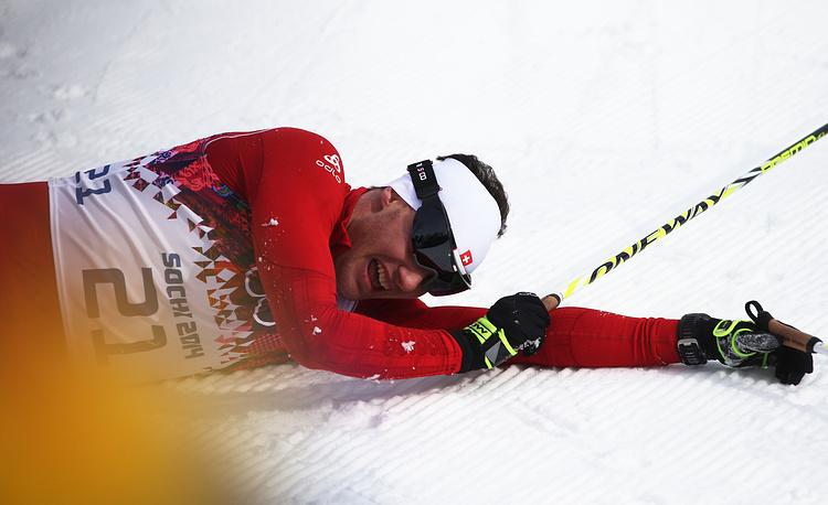Швейцарский спортсмен Дарио Колонья в финале соревнований по скиатлону