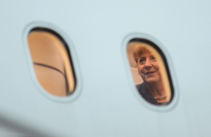 Федеральный канцлер Германии Ангела Меркель в правительственном самолете в аэропорту Вильнюса, Литва, 2013 год