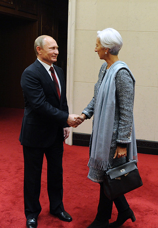 Президент РФ Владимир Путин и глава Международного валютного фонда Кристин Лагард на встрече в рамках делового саммита форума АТЭС