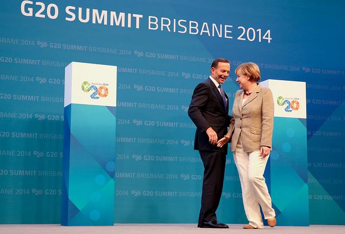 Премьер-министр Австралии Тони Абботт и канцлер Германии Ангела Меркель во время официального приема в честь открытия саммита G20
