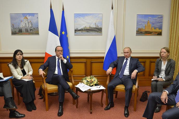 Президент Франции Франсуа Олланд и президент России Владимир Путин  во время встречи