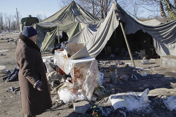 По сообщениям минобороны провозглашенной ДНР, около Дебальцева попали в окружение около пяти тысяч украинских военных. На фото: Дебальцево после отхода украинских военных, 21 февраля 2015 года