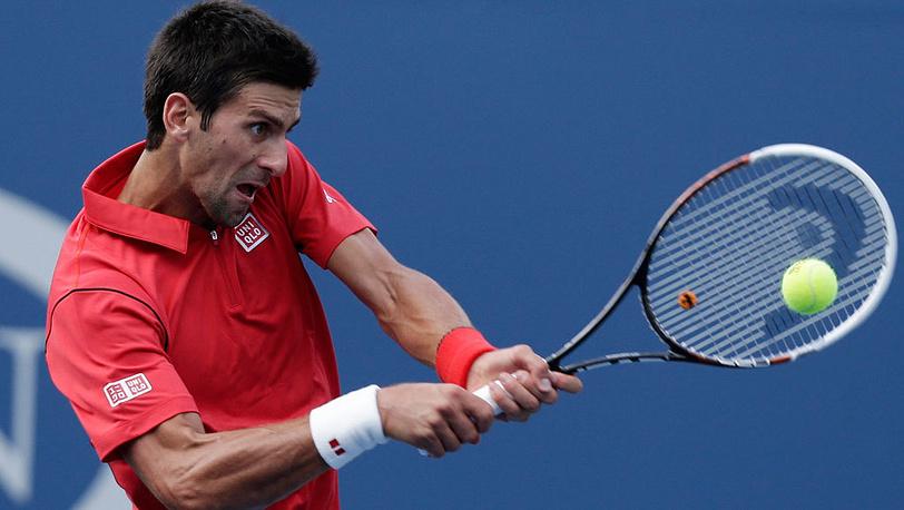 Серб Новак Джокович в матче против испанца Марселя Гранольерса в четвертом раунде Открытого чемпионата США по теннису. Фото EPA/JOHN G. MABANGLO