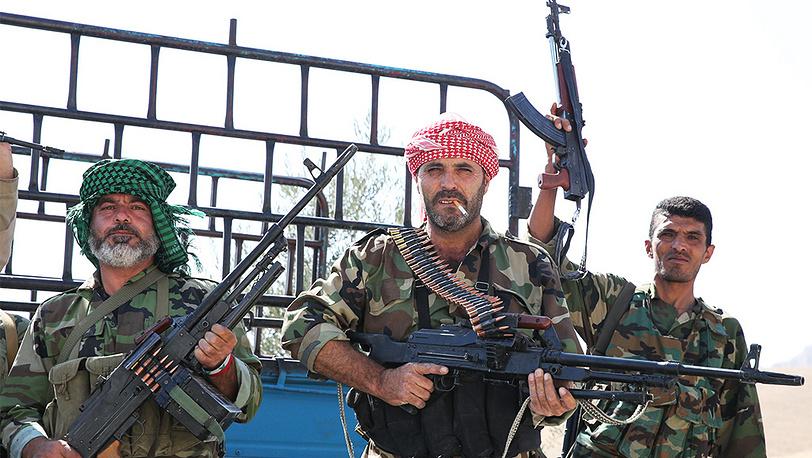 Ополченцы на территории поста вблизи города Маалюля к северо-востоку от Дамаска. Фото ИТАР-ТАСС/ Михаил Почуев