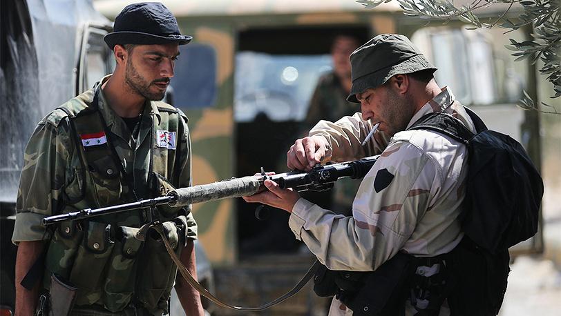 Солдаты сирийской армии вблизи города Маалюля к северо-востоку от Дамаска. Фото ИТАР-ТАСС/ Михаил Почуев