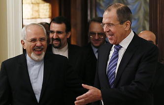 Russian Foreign Minister Sergey Lavrov (R) is seen with his Iranian counterpart Mohammad Javad Zarif (L) during their meeting in Moscow, 16 January 2014