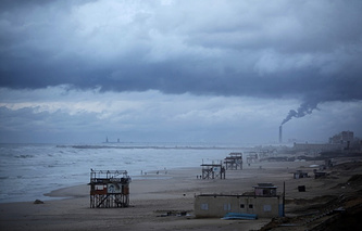 Mediterranean beach in Gaza City during a rain storm