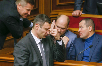 Ukrainian opposition leader Vitaliy Klitschko reacts during parliament's session in Kiev